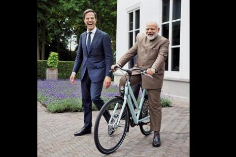 A picture shared by Prime Minister Modi on his twitter account shows him sitting and smiling on the Dutch-made bicycle which was gifted to him by Rutte. Photo: Twitter/@narendramodi