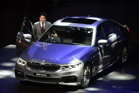 Sachin Tendulkar at the launch of the new BMW 5 series in Mumbai on Thursday. Deliveries of the car will start after GST implementation on 1 July. Photo: AFP