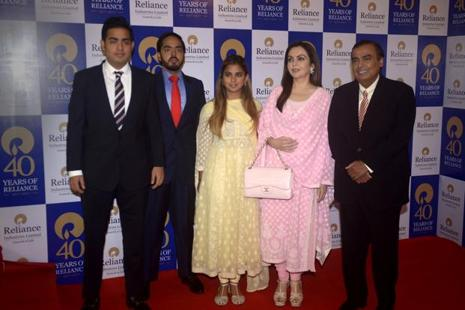 From right, Akash Ambani, Anant Ambani and Isha Ambani with father Mukesh Ambani, chairman of reliance Industries, and mother Nita Ambani, before the 40th Reliance Industries Annual General Meeting in Mumbai on Friday. Photo: Abhijit Bhatlekar/Mint