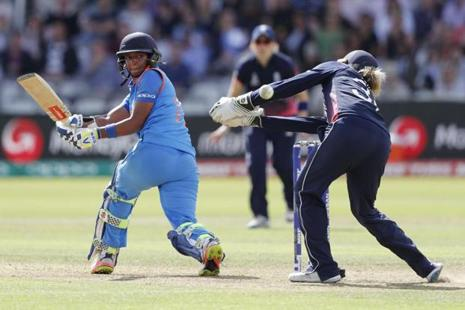 Harmanpreet Kaur plays a shot to reach her half century during the ICC Women's World Cup final between England and India at Lord's cricket ground in London. Photo: AFP