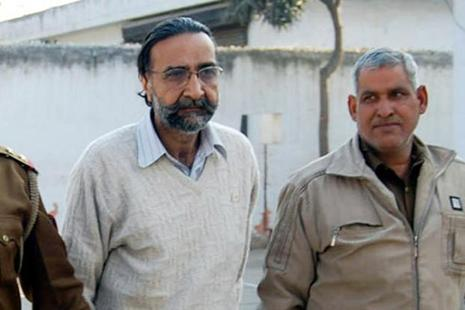 A file photo of Moninder Singh Pandher, centre, at Dasna Jail. Police had discovered 19 skeletons from Pandher's house in Nithari in Noida on 29 December 2006. Photo: Hindustan Times