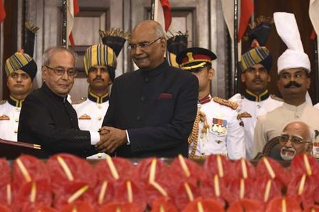 India's new President Ram Nath Kovind, greets former President Pranab Mukherjee, as Vice President Hamid Ansari (right) watches during the swearing-in ceremony on Tuesday. Photo: AP