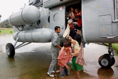 Indian Air Force personnel rescue flood-hit people in Banskantha district of Gujarat on Tuesday. Photo: PTI