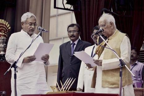 Bihar governor Keshri Nath Tripathi administers oath to Nitish Kumar as Bihar chief minister at the Raj Bhawan in Patna on Thursday. Photo: PTI