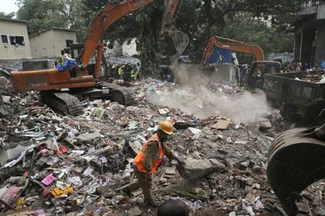 Rescuers look for survivors, after a five-storey building collapsed in the Ghatkopar area of Mumbai on Wednesday. Photo: AP