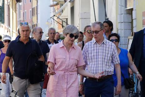 British Prime Minister Theresa May is currently on holiday in Italy. Photo: AFP