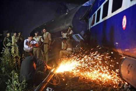 Rescue work is in progress near the upturned coaches of the Kalinga-Utkal Express. Photo: AP