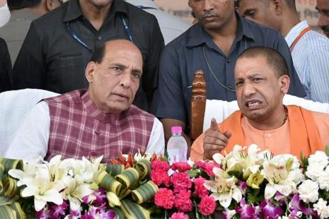 Union home minister Rajnath Singh with UP chief minister Yogi Adityanath during a function to distribute loan waiver certificates in Lucknow on Thursday.  Photo: PTI