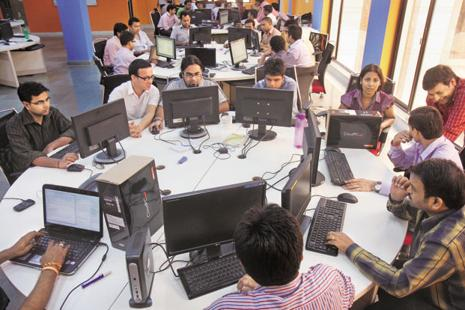 Constant regulatory changes cause several ongoing rewrites to the programming code in place at banks and will forever provide work for IT services firms. Photo: Hindustan Times