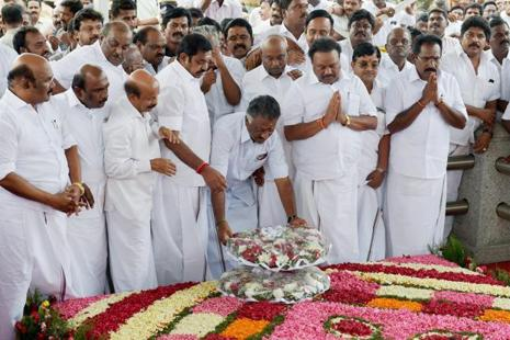 Tamil Nadu chief minister K. Palaniswami and O. Panneerselvam pay tributes at the memorial of late Tamil Nadu chief minister J. Jayalalithaa, following the merger of their factions in Chennai on Monday. Photo: PTI Photo