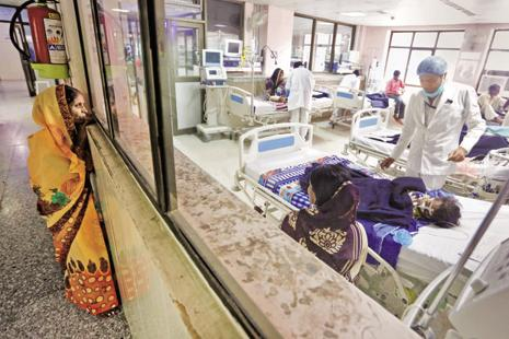 A file photo of BRD Hospital in Gorakhpur. Already struggling with low budgets, a dearth of expertise and embedded corruption in the layered public procurement system, government hospitals are unable to provide effective healthcare to the poor. Photo: Reuters
