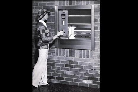 A woman using an automated teller machine (ATM) in 1974. Photo: AP