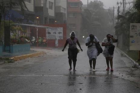 Women walk against the wind before the arrival of Hurricane Maria in Punta Cana, Dominican Republic, on Wednesday. Photo: Reuters