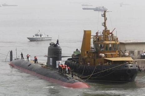 Indian Navy's Scorpene submarine INS Kalvari being escorted by tugboats as it arrives at Mazagon Docks Ltd, a naval vessel ship building yard, in Mumbai, on 29 October 2015. File photo:  Reuters