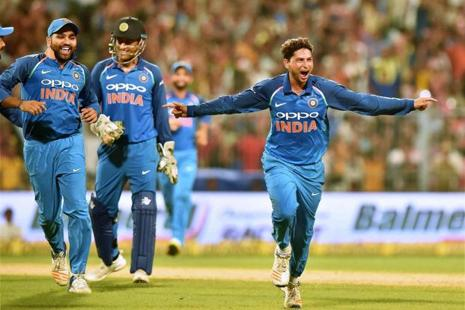 Kuldeep Yadav celebrates his hat trick against Australia during second One-Day International cricket match at Eden Garden in Kolkata on Thursday. Photo: PTI