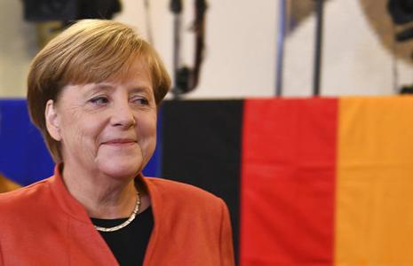 Chancellor Angela Merkel after she cast her vote in Berlin for in the Germany elections. She joins the late Helmut Kohl and Konrad Adenauer as the only post-war chancellors to win four national elections Photo: AP
