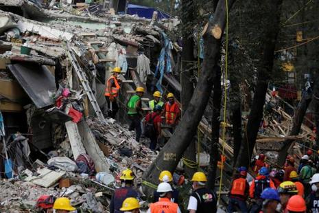 Members of the rescue teams and volunteers continue to search for people under the rubble of a collapsed housing unit, after an earthquake, in Mexico City, Mexico, on Saturday . Photo: Reuters