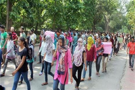Female students taking out a protest rally on the BHU campus in Varanasi on Sunday. Photo: PTI