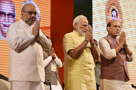 BJP president Amit Shah, PM Narendra Modi and home minister Rajnath Singh during the BJP national executive meeting in New Delhi on Monday. Photo: HT