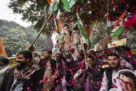 Congress workers celebrate their party's victory in assembly elections, in New Delhi on Tuesday. Photo: PTI