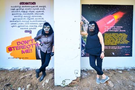 Two Guerrilla Girls at the Kochi-Muziris Biennale with their artwork. Photo: Aniruddha Chowdhury/Mint