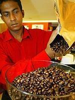 An employee atwork at  a Cafe Coffee day outlet in New Delhi. The Coffee board plans to emulate Brazil, which tripled consumption