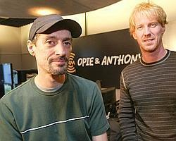 "Opie, right, whose real name is Gregg Hughes, and Anthony Cumia, left, of the radio show ""Opie & Anthony"" pose for a photograph in their studio, in this Oct. 8, 2004 file photo, in New York."
