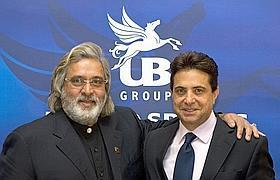 In high spirits: UB Group chairman Vijay Mallya (left) with Whyte & Mackay chairman and chief executive officer Vivian Imerman, after announcing the £595 million buyout of the Scotland-based disti