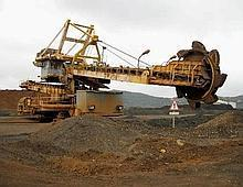 Piling up: A file photo of a bucket wheel reclaimer digging the earth at Eramet SA's ferronickel plant in Noumea, New Caledonia, in the US.
