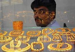 Fading glitter: A file photo of 22 carat gold jewellery on display in a New Delhi showroom. Sale of gold, traditionally, decreases in the monsoon.
