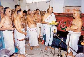 Priest R. Lakshmi Narasimhan with students at the institute