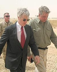 US ambassador to Iraq Ryan Crocker, left, walks with an aide at al-Asad airbase near the city of Hit in Anbar province in Iraq. Crocker will lead talks with Iran aimed at restoring security to Iraq.