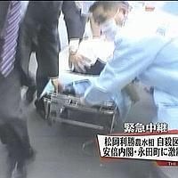 Japan's Agricultural Minister Toshikatsu Matsuoka, centre, is carried on a stretcher into a Tokyo hospital after been found in his apartment unconscious Monday, May 28, 2007 in this television grab