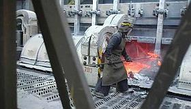 Forging ahead: A worker ladles molten aluminium in Russia. The per capita consumption of aluminium in China is 10kg a year, in Russia, 5kg, in the US, 34kg and in Germany, more than 50kg.