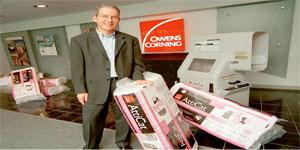 Research focus: Frank o' Brien-Bernini of Owens Corning, with a product to help reduce gas emissions from draughty attics in Columbus, Ohio, on 15 June 2007.