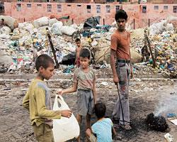 Youngsters at a slum in New Seemapuri live surrounded by the filth they collect from various neighbourhoods of New Delhi