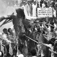 Against globalization? A file photo of members of the vegetable and fruit sellers' association burning an effigy of RIL chairman Mukesh Ambani in Bhopal during the statewide bandh to protest Reliance