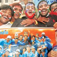 Back in the game: Cricket fans in Patna celebrate India's entry into the final of the Twenty20 World Cup on Sunday