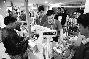 Shuffle in store: Employees at a Reliance Fresh store in Noida.