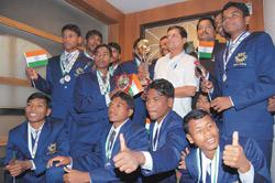 The victorious Jungle Crows team poses with the trophy at a Kolkata hotel