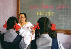 Yugandhara Thakur explains adolescence-related issues to girls of the municipal school No. 6 in Nerul, Navi Mumbai