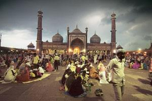 The pious: People wait outside Jama Masjid in Delhi to break their fast at sunset and offer 'namaz' or prayers
