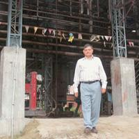 On edge: Virendra Singhal's paint factory on the outskirts of Lucknow has suddenly (and mistakenly) found itself in the middle of a newly re-zoned green belt