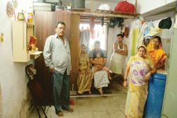 This 225 sq. ft apartment is home to the seven-member Sharma family, which has divided the room with plywood boards to afford some privacy
