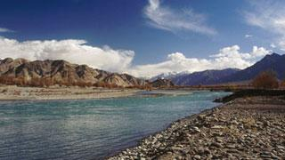 A different high: The brown and stormy Zanskar merges with the blue calm of the Indus