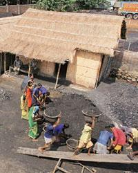 Labourers carry coal into a truck in Guwahati. The ­demand for coal in 2006-07 was 474.18mt, while supply was 432mt