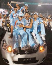 The Indian team takes a victory lap on the car presented to the man of the match Gautam Gambhir after the T20 match against Australia in Mumbai