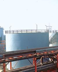 Fuel tanks at Essar's refinery at Vadinar in Gujarat