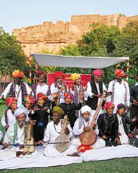 Desert song: (Clockwise from left) Mick Jagger and Maharaja Gaj Singh at a performance on the eve of the Rajasthan International Folk Festival at Mehrangarh Fort