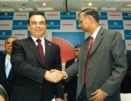 Partners on road: Nissan's Carlos Ghosn (left) with R. Seshasayee of Ashok Leyland on Monday.